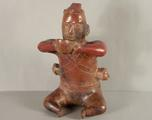 Colima Seated Figure / Vessel with Trophy Heads by