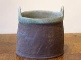 Stoneware oval 2-handled vessel with turquoise rim and interior by Paul Philp