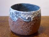 Stoneware bowl with textured rust body and turquoise rim and interior by Paul Philp