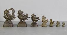 7 Burmese bronze animal-shaped <br/> opium weights by