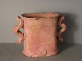 Rough textured terracotta glazed vase with curly handles by Colin Pearson